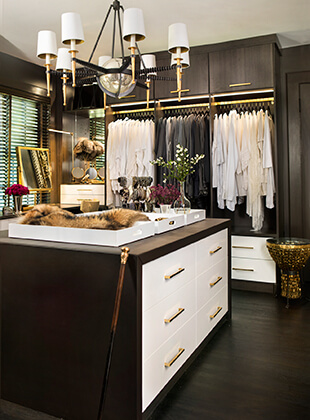 Closet Is Outfitted In A High Contrast Combination Of Warm Gray And Glossy  White Finishes.