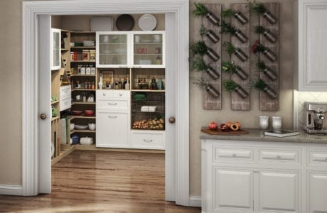 California Closets white kitchen pantry with natural light wood finish shelving