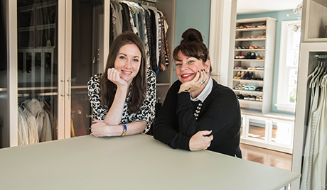 Stylist Linda Martinez and her designer posing in her newly renovated closet