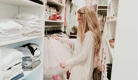 California Closets client Erika Altes selects a skirt from her newly organized closet