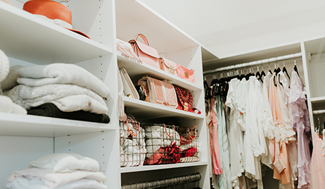 Organized clothing and accessories in the new closet for client Erika Altes