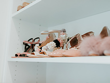 White shoe shelving in the new closet for client Erika Altes