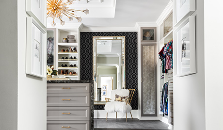 Walk in Closet with White Shelving Shoe Racks Island Dresser and Body Length Mirror