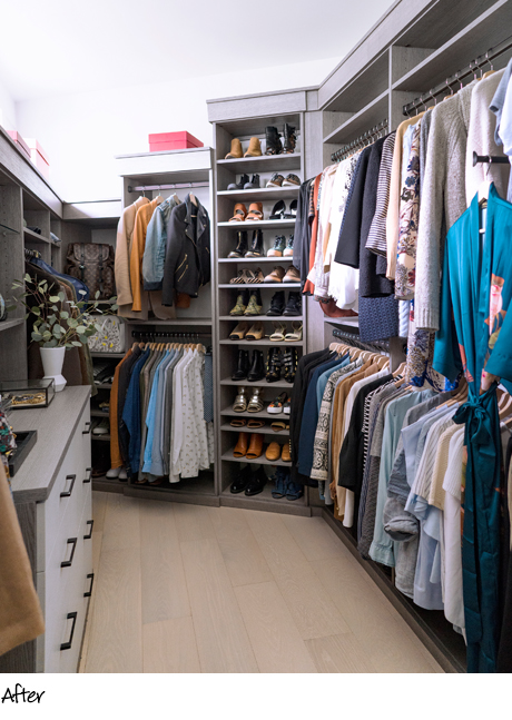 Organized clothes hanging in a renovated walk in closet with light gray shelving