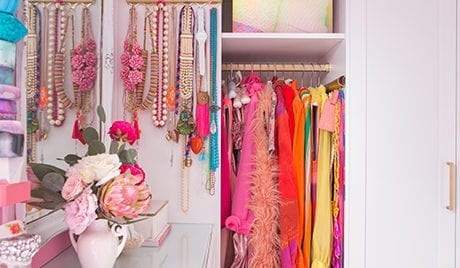 Organized colorful hanging jewelry and clothing