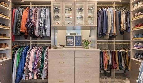 Full view of sleek light tan masculine custom closet for California Closets client David Ligon