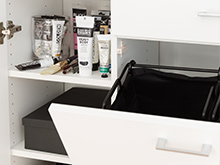 Pull out hampers with cabinet shelving housing makeup
