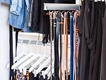 Slide out belt rack in the California Closets custom closet for client Erin Swift