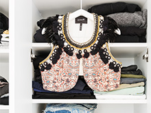 Decorative women's top displayed in California Closets client Erin Swift's new closet