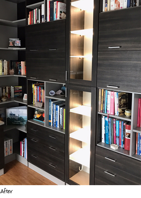 Dark gray wooden bookshelves with LED lit display shelving
