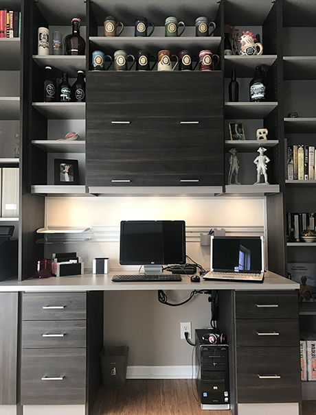 Dark grey wooden work space with laptop and shelving for coffee mug collection