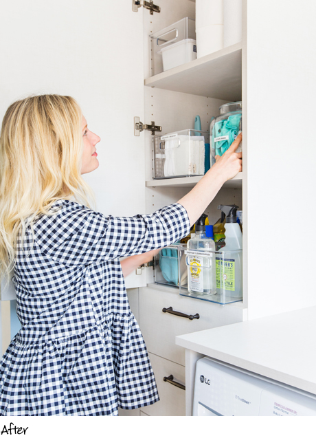 California Closets client Emily Henderson putting away items in her new laundry room cabinets