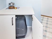 Custom white enclosed cabinet containing a kitty litter box