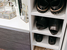 Shoes organized in white cubbies