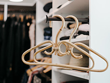 Gold decorative hangers hanging from bronze hanging poles