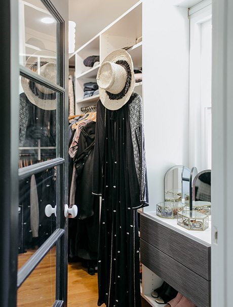 Glass door opening to California Closets client Victoria Smith's custom walk in closet