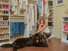 California Closets client Ari Perez and her dog posing in her organized custom closet