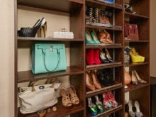 Shelving with purses displayed and shoe shelves in the closet of client Danielle S.