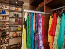 Colorful scarf pull out rack in the closet of client Danielle S.