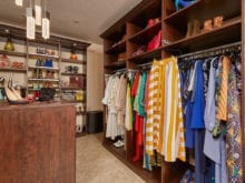 The fully furnished brown closet of California Closets client Danielle S.