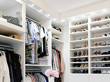 Organized shelves with accessories and clothes in the closet of client Kimberly Lapides