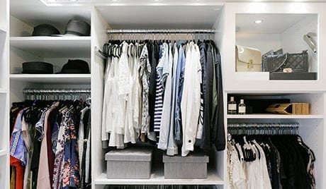 An organized closet with clothes and accessories for client Kimberly Lapides