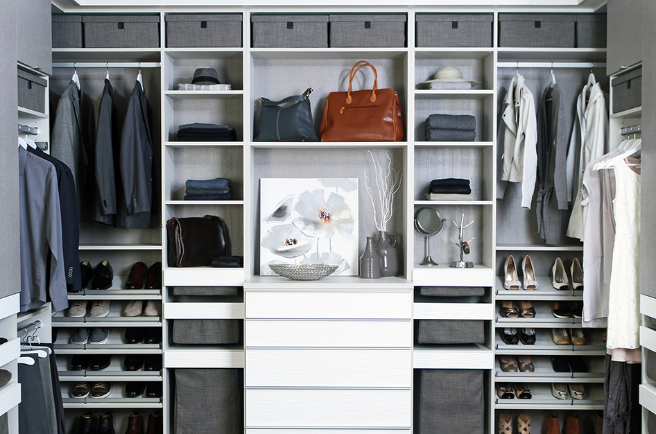 Furnished interior closet with shelving for hats, shoes, purses, and coats.