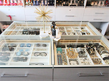 Local Client Story Jenna Markham Close Up of Glass Table Top with Stainless Drawers