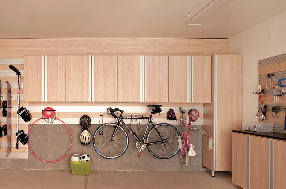 Custom garage with cabinets and racks for snowboards, bikes and more.
