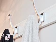 California Closets silver bathroom hooks With White Base Board