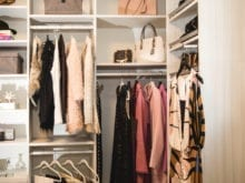 Damon and Wendy Commercial Client Story White Finish Walk in Closet with Metal Hangers