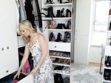 Kristine Leahy Client Story California Closets Classic White Walk In Closet with Stainless Hardware
