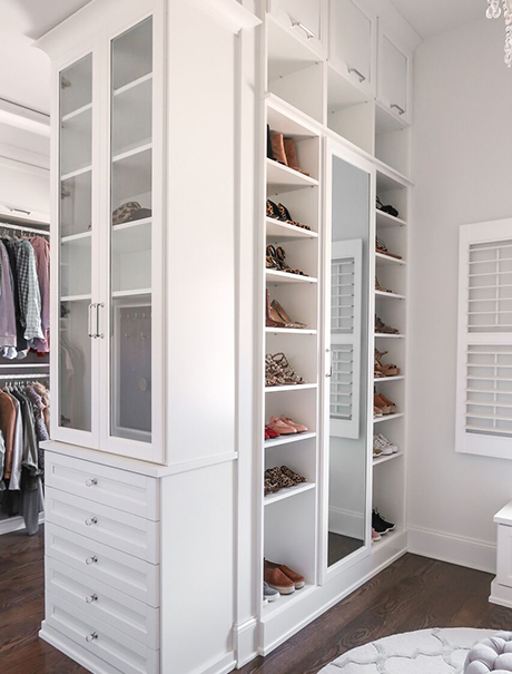 White Closet Storage Solution with Clear Glass Cabinets and Mirror Front