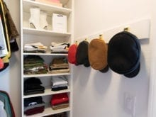 Client Stories Lana Alicia New Walk In Closet with Gold Hardware and Hat Storage
