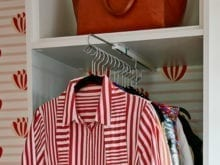 Close Up of Striped Shirt in New Closet