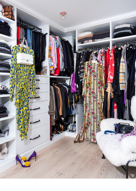 Dresses displayed on valet rods in the new walk in closet for blogger Olivia Song