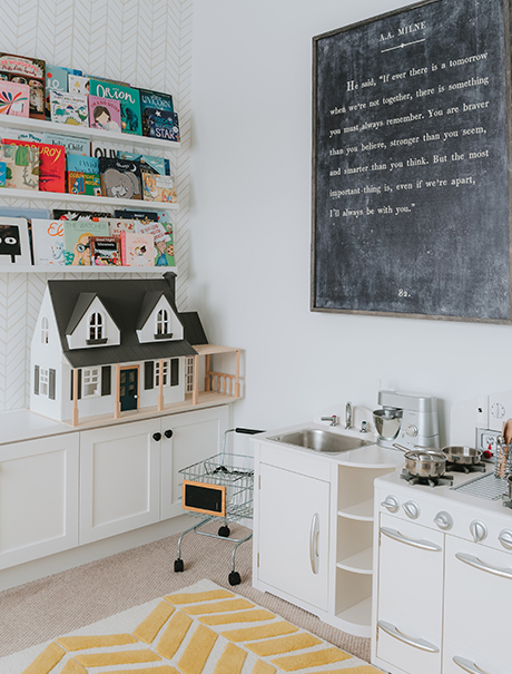Toys and a play kitchen organized with a California Closets custom playroom storage cabinet