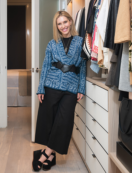 California Closets client Jamie Rosen posing happily in her new custom closet