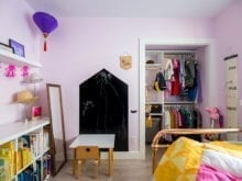 Light purple child's bedroom with California Closets book shelf and closet