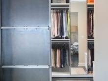 Display of hanging space in the custom closet of Adam Glassman