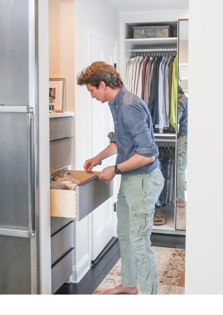 Creative Director Adam Glassman utilizing the drawers in his custom master closet