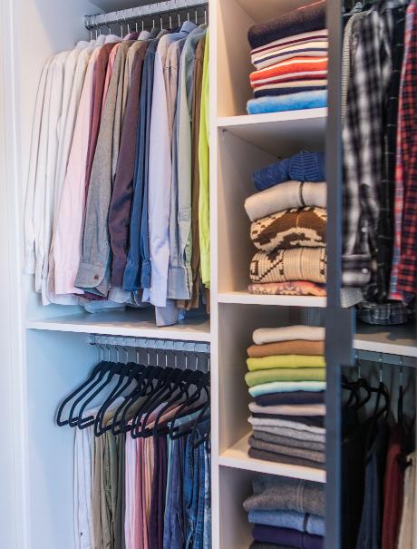 Organized clothes in the custom master closet for Adam Glassman
