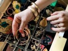 Hannah Crowell reaching into her jewelry organizer inside California closets dresser drawer