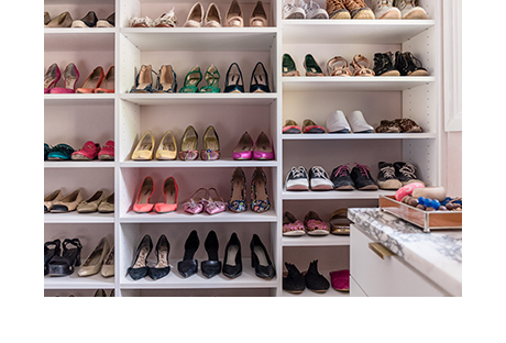 White shelving with colorful shoes in walk-in closet for Hannah Crowell