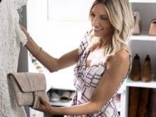Kristen Lawler looking at white dress in custom closet