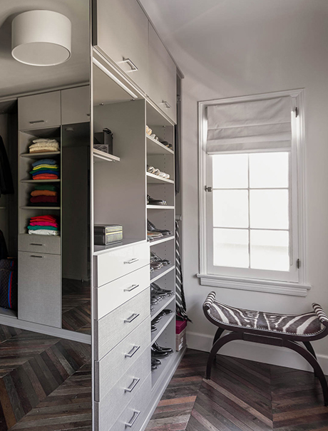 Custom shelving, cabinets, and accessory display in the mast closet for Brad Goreski