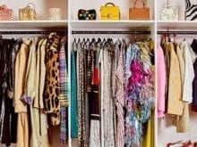 Sample clothing organized on hanging rods and shelves in Man Repeller office