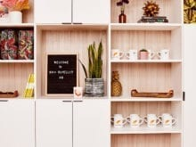 Optimized office shelving by California Closets for Man Repeller headquarters