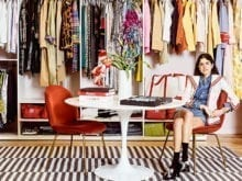 Open hanging and shelving for clothing displays in Man Repeller office