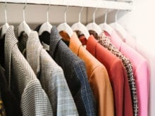 Vlogger Shea Whitney's colorful blazers on white hangers | California Closets